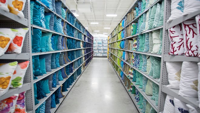A bedding aisle inside a typical At Home store.