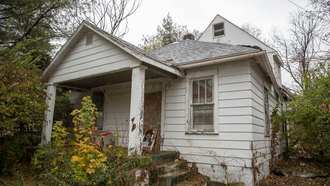 A dilapidated home at 220 S. Dill St. is one of 54 properties that is being sought for demolition with the city's blight removal effort. So far the city has seen 81 properties demolished.