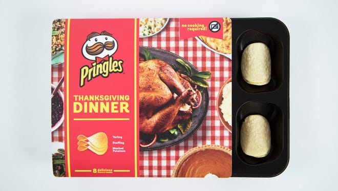Pringles new Thanksgiving Dinner contains a tray of chips with eight new flavors.