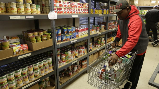 About 20 people used the food pantry at the Salvation Army in Oshkosh on a mid-November day.