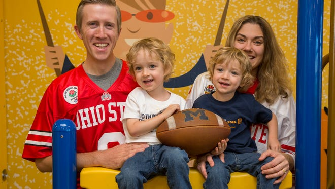 Aaron and Stephanie Gonya of Port Clinton, pictured here with their twin sons Ian and Michael, are Ohio State University fans who also will be rooting for the University of Michigan. In 2014, the twins underwent fetal surgery in Ann Arbor for twin-to-twin transfusion syndrome.
