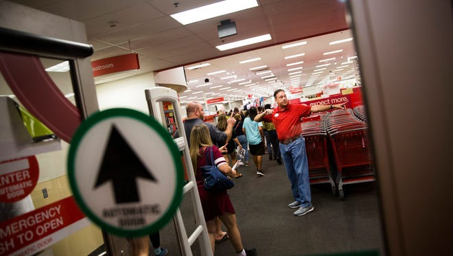 Chris Eddy, manager, directs shoppers on Thursday, November 23, 2017 at the Target on Pine Ridge Road and Airport Pulling Road in North Naples.