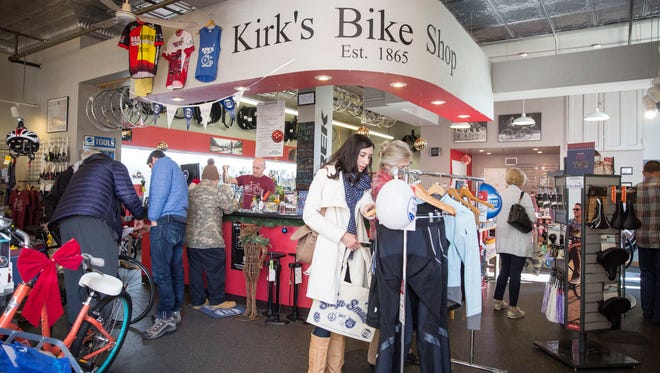 Shoppers look for holiday gifts and deals at Kirk's Bike Shop in downtown Muncie as a part of Small Business Saturday in 2017.