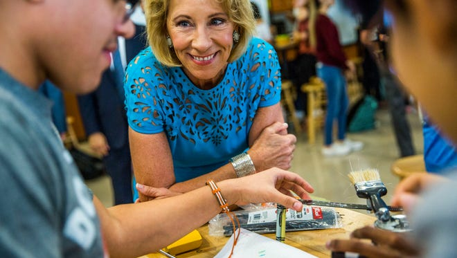 U.S. Education Secretary Betsy DeVos visits with a robotics class at FSW Collegiate High School on Monday, Nov. 27, 2017.