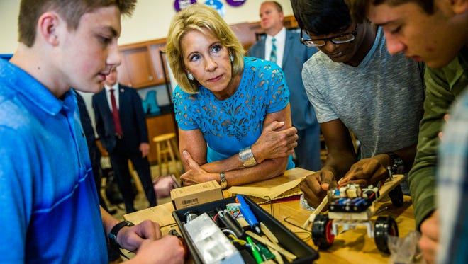 U.S. Education Secretary Betsy DeVos visits with a robotics class at FSW Collegiate High School in Fort Myers on Monday, Nov. 27, 2017.