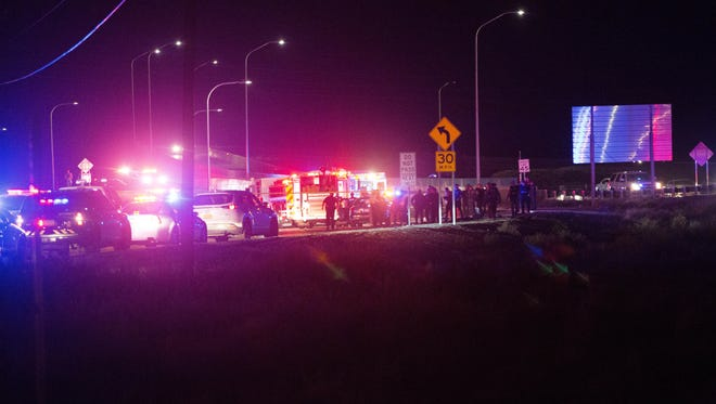 Las Cruces police and fire department officials and United State Border Patrol agents respond to a crash on Las Alturas preceded by a high speed vehicle chase through Las Cruces. Monday, Nov. 27,2017.