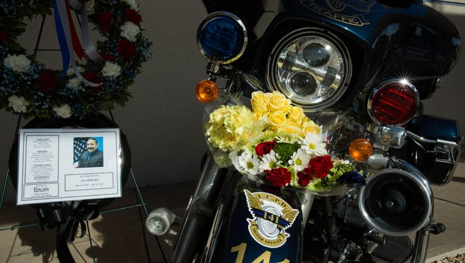 A memorial outside the main Las Cruces Police Station, including the motorcycle that J.R. Stewart rode while still serving with the Las Cruces Police Department. Thursday Nov. 30, 2017.