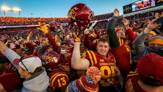 Iowa State players and fans celebrate after defeating TCU 14-7 at Jack Trice Stadium Saturday, Oct. 26, 2017.