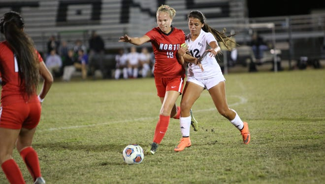 North Fort Myers' Emilee Hauser competes with Mariner's Arianna Quintanilla.