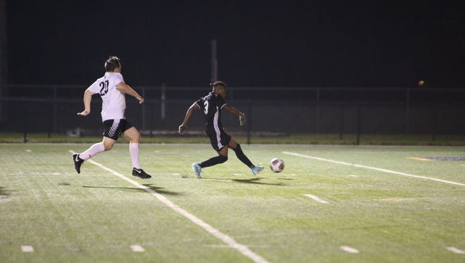 Mariner's TJ McKay scores a goal  during a boys soccer match between Mariner and Bishop Verot.