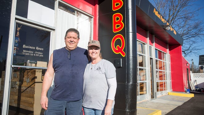 Mandy and Travis Thorrington stand outside their restaurant, MT's Smokin Barbecue, which just recently opened at 1700 N. Wheeling Ave. The restaurant has a narrow menu so they can focus on offering fresh smoked meat on a daily basis.