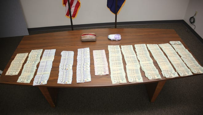 Detectives seized methamphetamine, cash, cocaine and heroin in a recent drug bust.