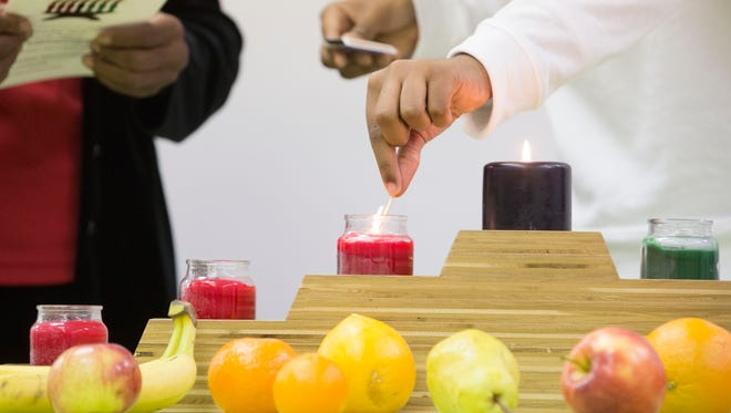 Each kinara candle, part of the symbolism of Kwanzaa represents a different principle. These can range from Unity and self-determination to collective work and cooperative economics.