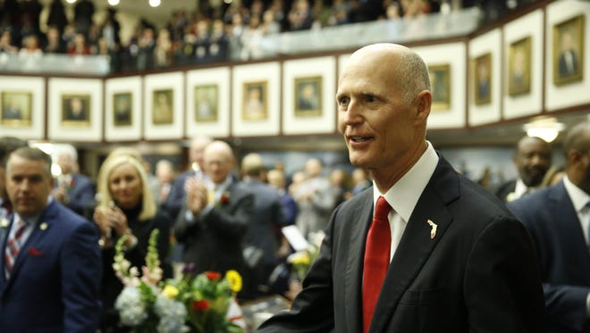 Governor Rick Scott enters the house chambers before his State of the State Address on the opening day of the 2018 legislative session.