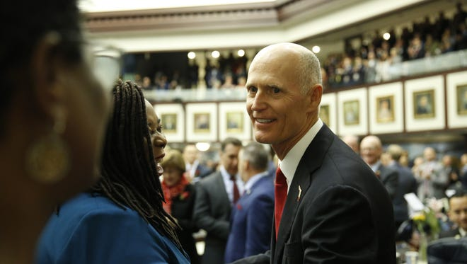 Governor Rick Scott enters the house chambers before his State of the State Address  Tuesday, the opening day of the 2018 legislative session.