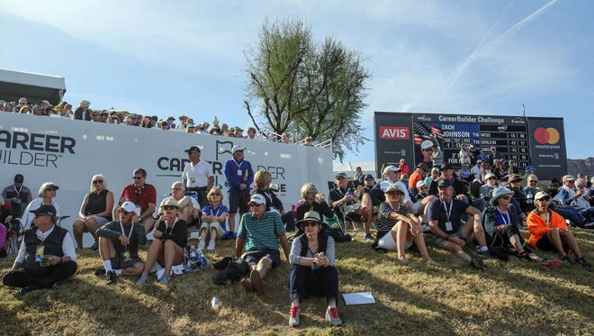Spectators watch the golf action on 17 during the final round of the CareerBuilder Challenge on Sunday, January 21, 2018 in La Quinta, CA.