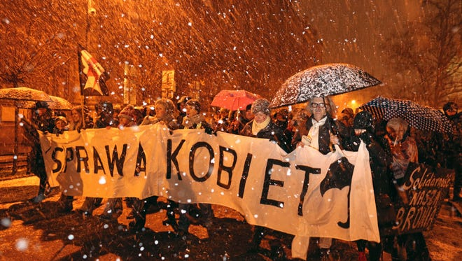 People carry a banner 'Woman's thing' during the 'Black Wednesday' protest organized by Polish Nationwide Women Strike, against plans to tighten abortion laws in Krakow, Poland, on Jan. 17, 2018.