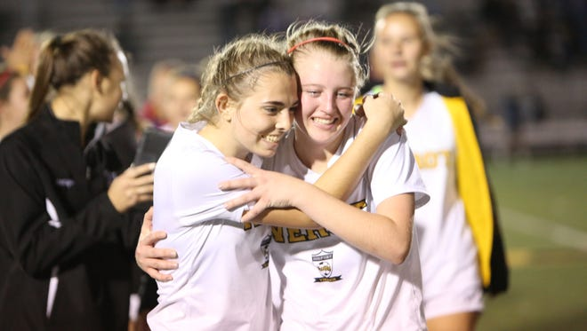 Bishop Verot players celebrate their 1-0 District 2A-12 title win over Oasis in girls soccer.