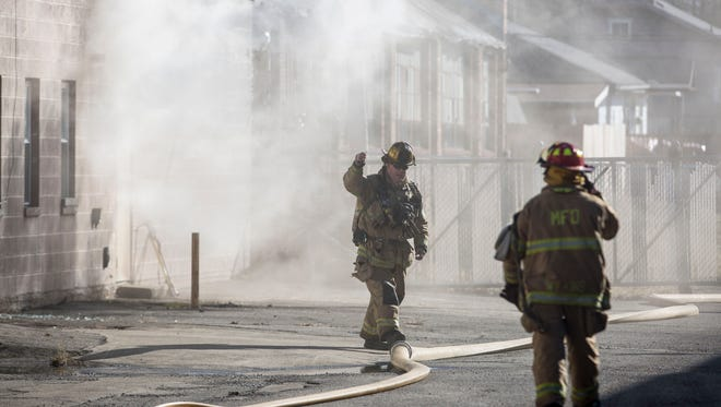 Emergency responders attempt to battle an industrial fire on Jan. 28 in the 900 block of South Mound Street. All but one of Muncie's fire engines were called to the scene to prevent the fire from spreading to more of the warehouses in the block.