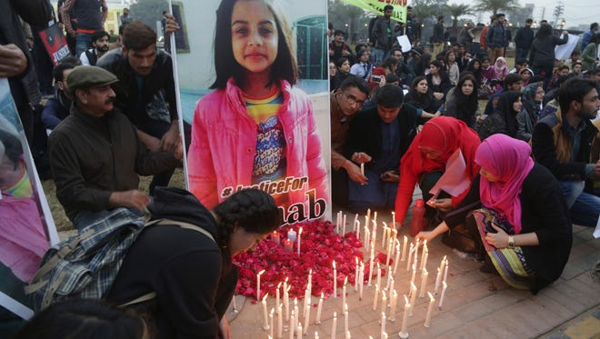 Pakistani students light candles during a rally on Jan. 11, 2018, to condemn the rape and killing of Zainab Ansari, 7, in Kasur.
