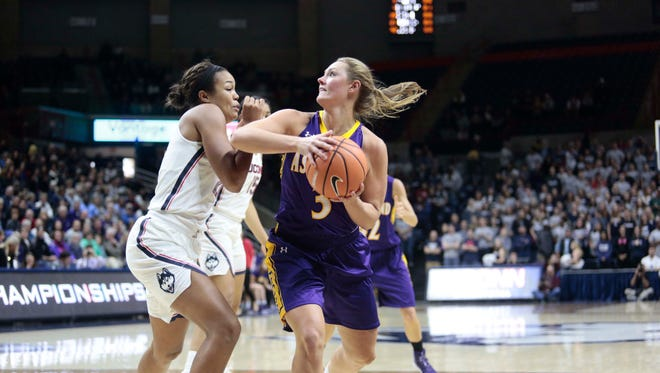 Ashland University's Laina Snyder looks to score in an exhibition game against the University of Connecticut before this season. UConn owns the NCAA record for most consecutive wins in Division I, a title AU now holds in Division II.