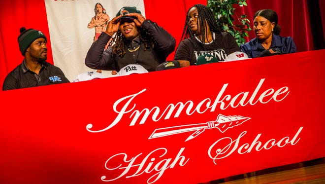 Abraham Alce announces he will be playing college football at the University of Akron during National Signing Day at Immokalee High School on Wednesday, Feb. 7, 2018.