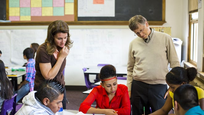 Bill and Melinda Gates during a 2012 visit to a classroom in at South Denver High, where they worked with students on assignments.