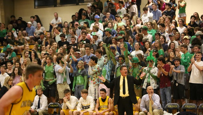 Bishop Verot boys basketball coach Matt Herting coaches against Fort Myers on Feb. 11 at John J. Nevins Gymnasium with the Fort Myers student section behind him. Administrators from both schools said the rivalry game won't be played during the 2018-19 season.