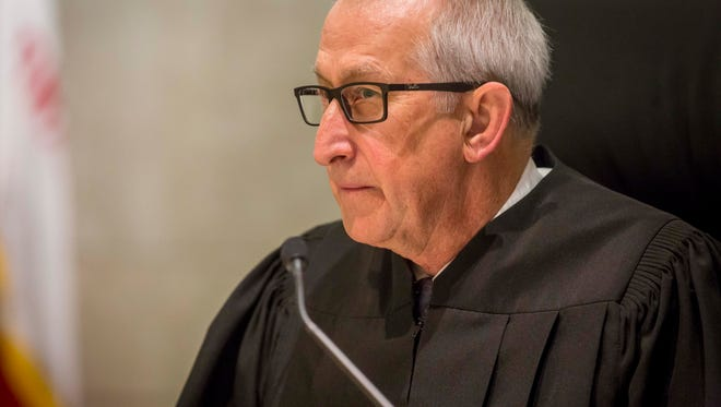 Justice Bruce B. Zager listens to lawyers during oral arguments on the Planned Parenthood v. Reynolds case at the Iowa Supreme Court Wednesday, Feb. 14, 2018, in Des Moines, Iowa.