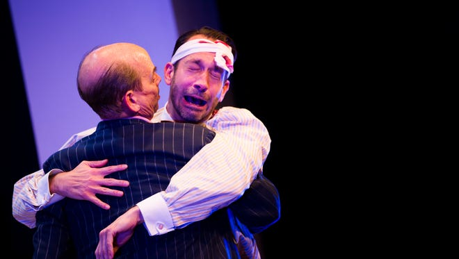 Jeffrey Binder, as Scapino, falls into the arms of Lary Paulsen, as Don Jerry GŽronte, during a dress rehearsal for Scapino at Norris Community Center on Wednesday, February 14, 2018 in Naples, Fla. The play will run from February 17 through March 18.