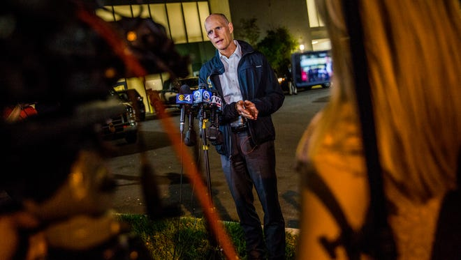 Governor Rick Scott addresses the media during a press briefing outside of Broward Health North in Pompano Beach, Fla. after a shooting at Marjory Stoneman Douglas High School in Parkland, Fla. on Wednesday, Feb. 14, 2018.