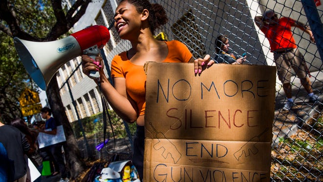 South Broward High School sophomore Genesis Campbell leads her classmates in protest in front of their school on Friday, Feb. 16, 2018 in response to a shooting at Marjory Stoneman Douglas High School in Parkland, Fla. on Wednesday that took 17 lives.