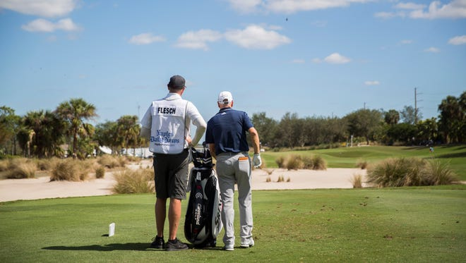 Steve Flesch consults with his caddy before teeing off at the fifth hole during the Chubb Classic in Naples on Friday, February 16, 2018.