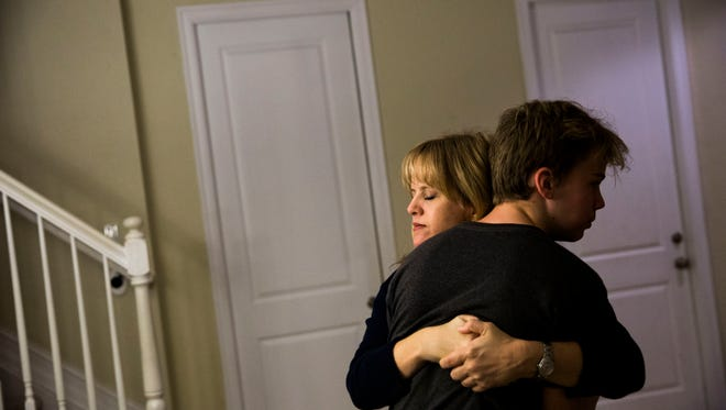 Annika Dean hugs her son Austin Foote, 13, in their Parkland, Fla. home on Monday, January 9, 2017. Dean survived Friday's shooting at Fort Lauderdale-Hollywood International Airport.