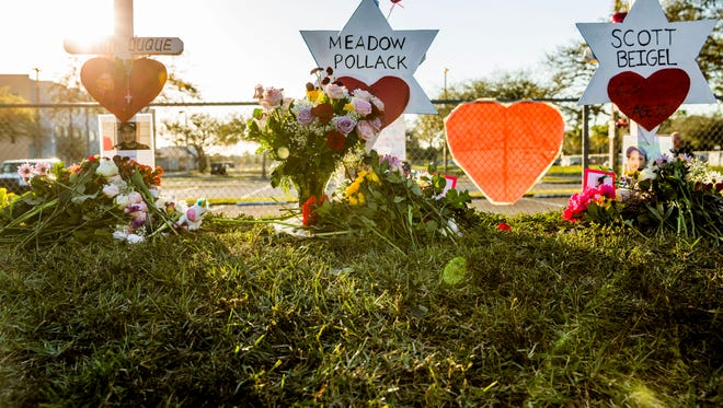 A memorial outside of Marjory Stoneman Douglas High School in Parkland, Fla. on Sunday, Feb. 18, 2018 in response to a shooting at the High School on Wednesday that took 17 lives. Today was the first day the public was allowed to visit the perimeter of the school since the shooting.
