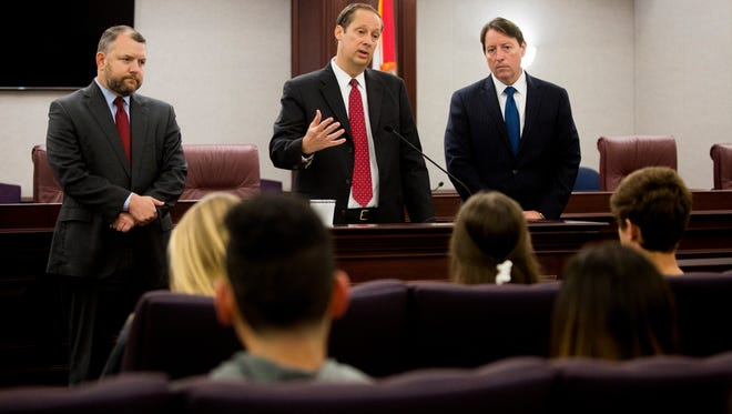 Florida state Sen. Rob Bradley, from left, Senate President Joe Negron and Sen. Bill Galvano speak during an initial question-and-answer session with students from Marjory Stoneman Douglas High School at The Capitol Complex early Wednesday, Feb. 21, 2018, in Tallahassee, Fla. Students posed questions regarding gun control after a mass shooting took 17 lives at their school last week.