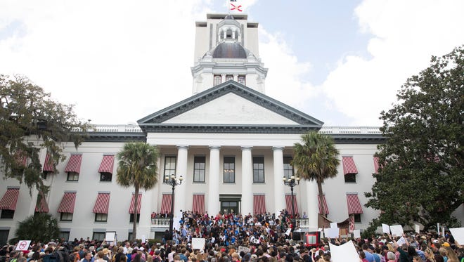 A week after a mass shooting claimed 17 lives at Marjory Stoneman Douglas High School in Parkland, Fla., a rally was held outside the Florida State Capitol to advocate for stricter gun control and better mental health care Wednesday, Feb. 21, 2018, in Tallahassee, Fla.
