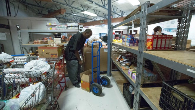 Chris Boykin unloads boxes of cookies and cakes into the food bank of Casa de Peregrinos Friday Feb 23, 2018. Casa de Peregrinos provided 3.2 million pounds of food to those in need in 2017.