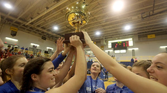 Haldane celebrates with the Gold Ball trophy after defeated the Keio Academy 50-30 in the Section 1 Class C Championship at Pace University in Pleasantville Feb. 24, 2018.