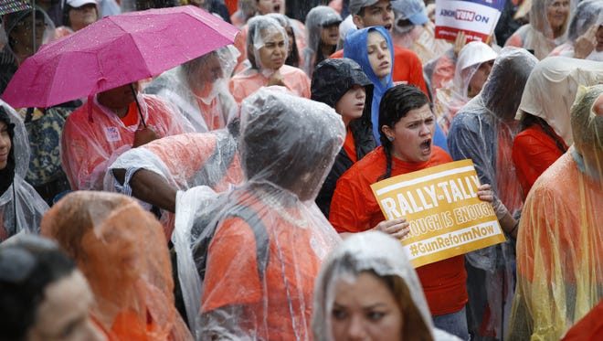 Hundreds of protesters braved Monday's downpour to call on legislators to pass stricter gun laws during the Rally in Tally at the Capitol.