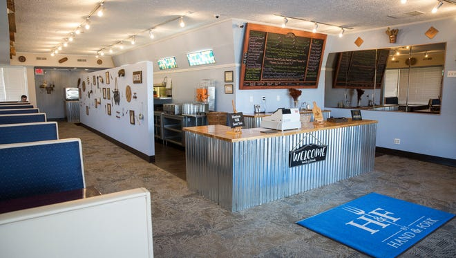 By Hand and Fork opened on Monday with a southern comfort style decor and menu. The restaurant has unlimited sides served up family style for their dinners.