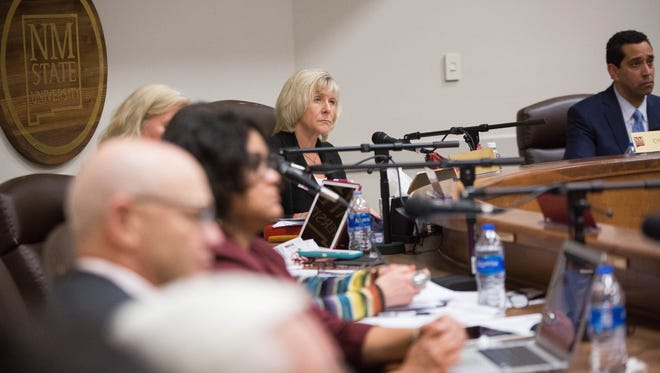 Debra Hicks, chairwoman of the New Mexico State University board of regents, along with the rest of the board, listens to faculty and staff who had concerns about the proposed transfer  of $1.1 Million dollars from the ING fund to the Athletics department. Tuesday March 6, 2018.