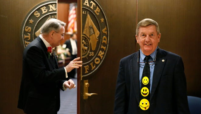 Tommy Hunt, who works for the Senate Sergeant at Arms, has been wearing the same smiley face tie for the opening day of session for 33 years. Here he mans the door to the Senate chambers on Tuesday, Jan 9, 2018, the opening day of the legislative session.