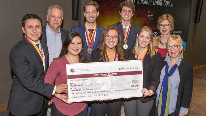 The DriGo team won the grand prize at FSU's Jim Moran School of Entrepreneurship InNOLEvation finals. FRONT ROW: Jose Miranda (student-far left); Brianna Yeung (student-left center); Megan Simpson (student-center); Claire Kelly (student-right center); Susan Fiorito, Director, Jim Moran School of Entrepreneurship (far right). BACK ROW: Mark Scott (benefactor-far left); Hunter Wheeler (student-left center); Billy Courson (student-right center); Wendy Plant, Jim Moran School of Entrepreneurship (far right).