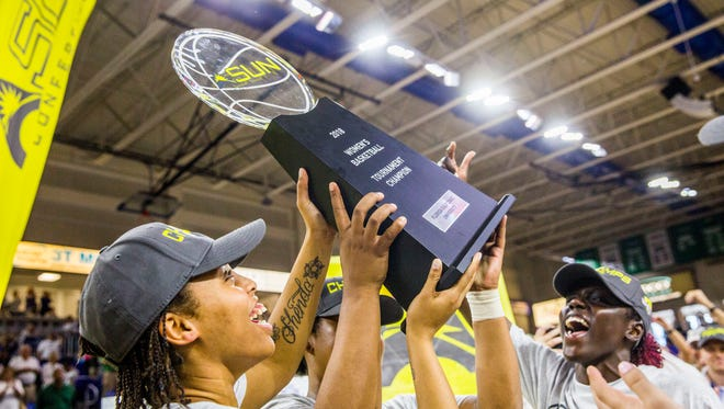 The FGCU women's basketball team celebrates winning the A-Sun Tournament championship against Jacksonville in Estero on Sunday, March 11, 2018.
