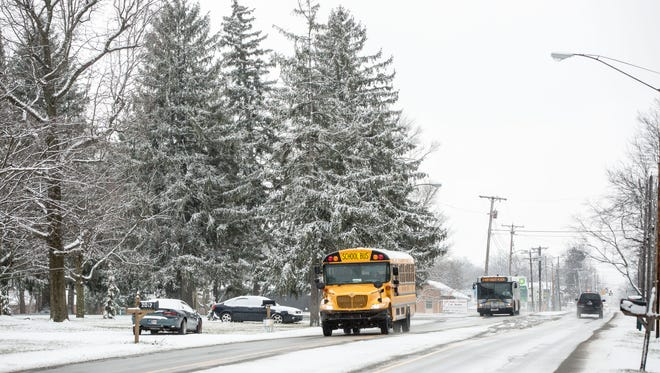 File photo of school bus driving in the snow from March 2017.