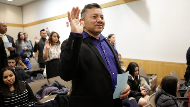 Luis Torres of Port Chester is naturalized as a United States citizen at the White Plains County Court House on Feb. 22, 2018.