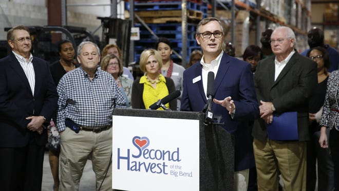Rick Minor, CEO of the Second Harvest of the Big Bend, speaks at a press conference at the food bank's warehouse Wednesday, March 21, 2018, thanking legislators for the $1 million set aside for the organization in this year's state budget.