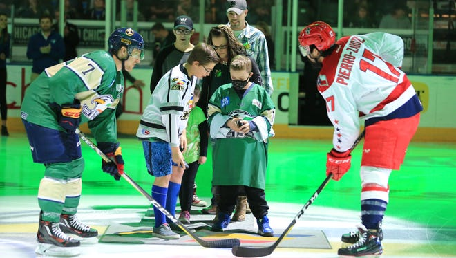 The Colorado Eagles did more than clinch an ECHL playoff spot last week. They also helped raised $60,057 for 12-year-old Malaki Turner of Longmont, shown with a mask dropping the ceremonial puck at Saturday's game. Turner has cystic fibrosis. This was the seventh year the Eagles have raised money as part of its Pot of Gold game. This year's total was the most raised in the history of the event.