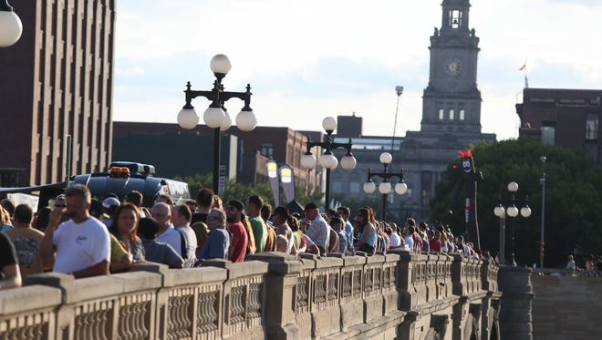 A crowd gathers on the Court Avenue bridge for a concert as part of the RAGBRAI festivities in 2013 during an overnight stop in Des Moines.